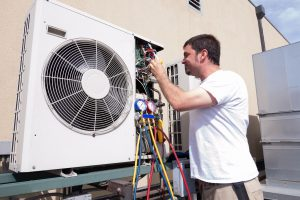 Man doing ac services in Dubai.