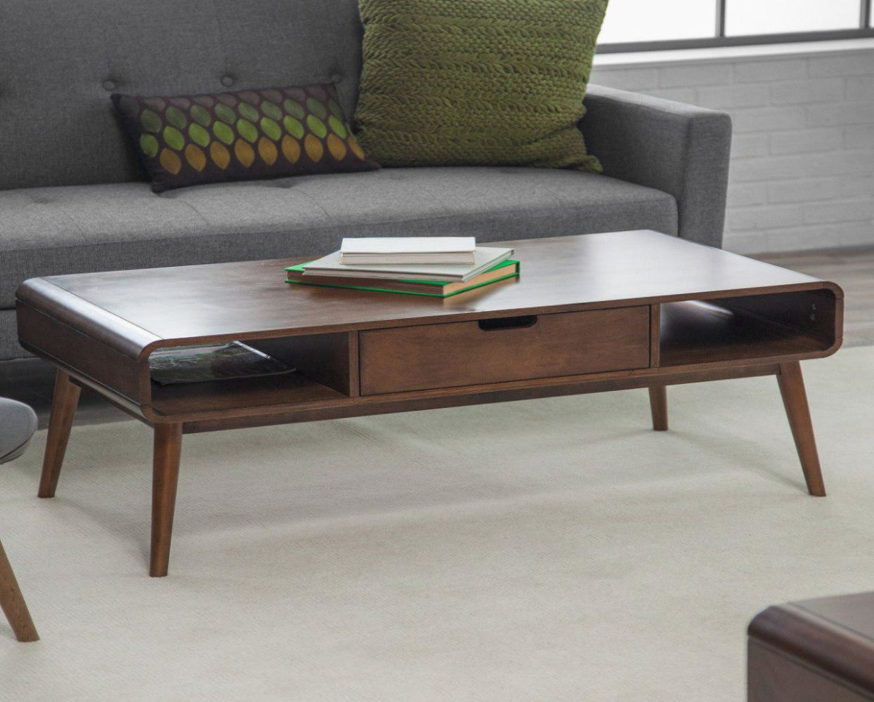 Wooden coffee table with books and sofa - Taskmasters Dubai