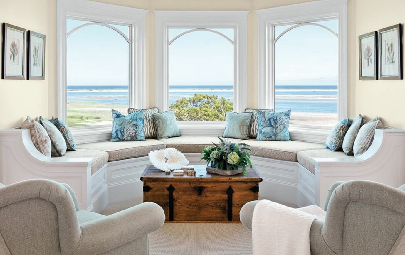 Living room with windows facing sea - Task Masters